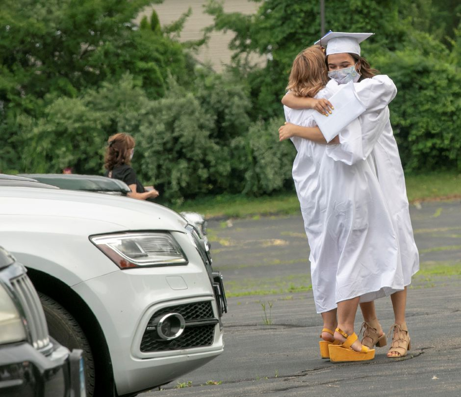 Twin sisters, from left, Lola and Ava Julia embrace after receiving their diplomas during Sheehan High School graduation ceremonies at the Toyota Oakdale Theatre in Wallingford on Monday. Photos by Dave Zajac, Record-Journal