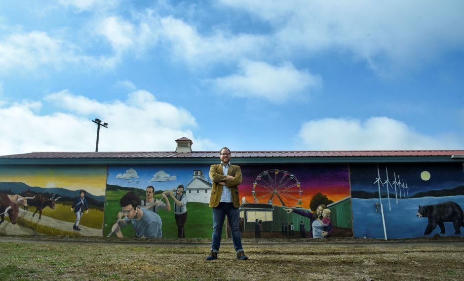 Durham native and Middlefield resident Mike Golschneider poses last Saturday  with the mural he painted at Allyn Brook Park in Durham.
