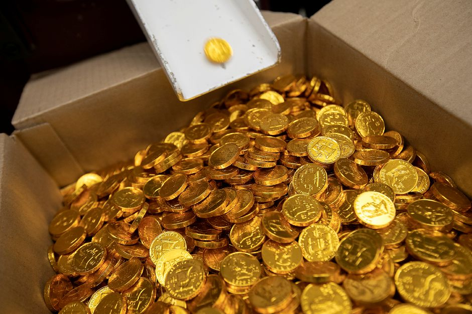 Chocolate coins drop into a box at the end of the production line at Thompson Chocolate, 80 S. Vine St., Meriden, Tues., Feb. 4, 2020. Thompson Chocolate is one of 18 stops on the Connecticut Chocolate Trail. Dave Zajac, Record-Journal