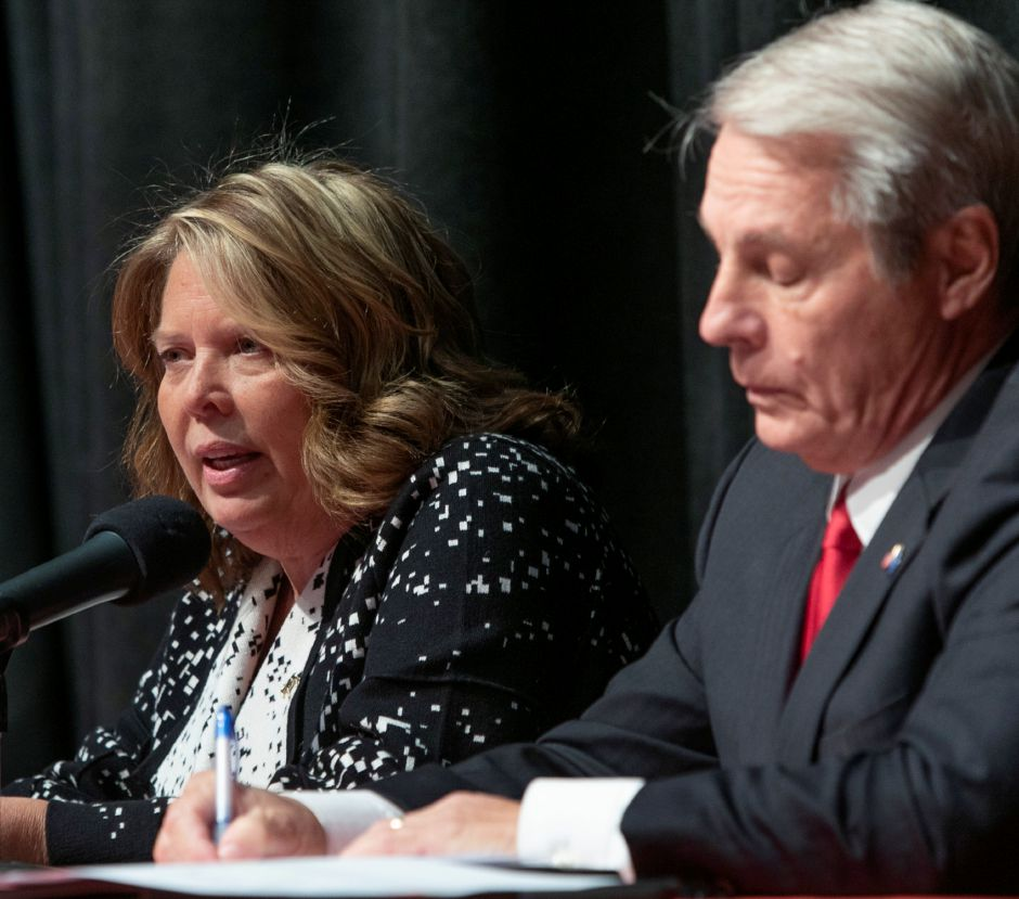 Democratic nominee Mary Dougherty Abrams speaks next to Sen. Len Suzio, R-Meriden during a debate at Washington Middle School sponsored by the Record-Journal, Midstate Chamber of Commerce, and Meriden Board of Education, Thursday, Oct. 18, 2018. Republican, Democratic and Libertarian candidates in three local races were sharply divided Thursday on the implementation of tolls, how to close a 4.5 billion deficit, and other issues. Dave Zajac, Record-Journal