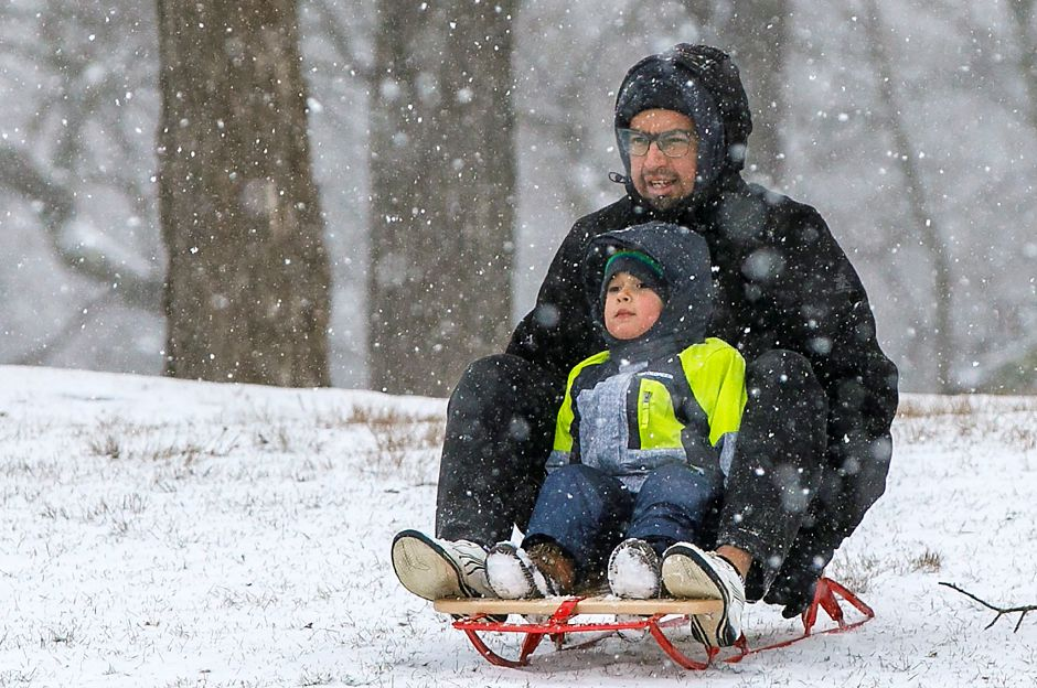 Rene Gallosa and son Matthew, 3, of Plainville, start their sled down a snowy hill at Hubbard Park in Meriden, Tues., Jan. 26, 2021. Snow will continue into tonight bringing two to four inches of accumulation. Dave Zajac, Record-Journal