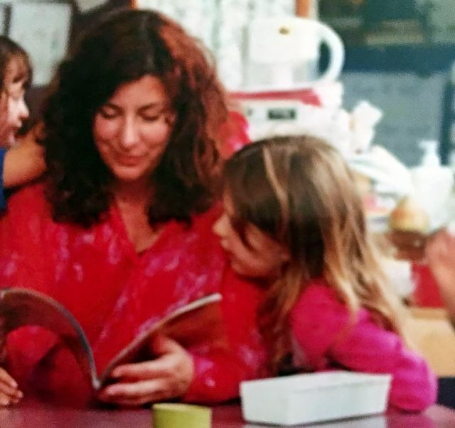 This photo provided by Tara Reade shows Tara Reade reading a book with her seven-year-old daughter at her daughter