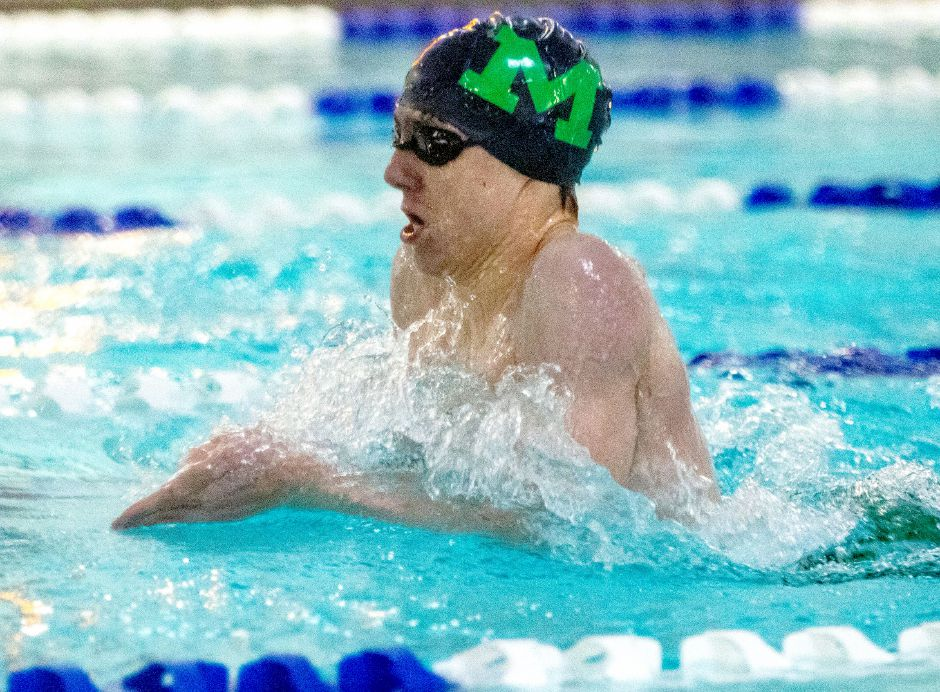 Sam Hurlburt, a Maloney sophomore on the Meriden Co-op, broke a 20-year-old Maloney record when he swam a 1:03.98 to win the CCC South championship in the 100 breaststroke. Aaron Flaum, Record-Journal