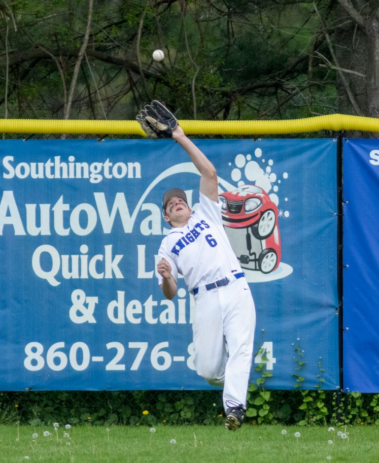 Jack McManus, seen here catching a fly ball during Monday's game against East Catholic, socked a two-run home run to provide all the scoring in Southington's 2-0 CCC West baseball victory over Farmington on Friday night at Southington High School. Aaron Flaum, Record-Journal