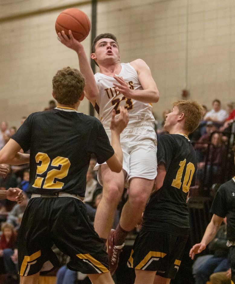 Sheehan's Jack McDonnell splits the defense of Daniel Hand's Trey Adams, left, and Scott Testori during a game last season in Wallingford. McDonnell, a four-year varsity player, has committed to Division III Suffolk University in Boston. Aaron Flaum, Record-Journal