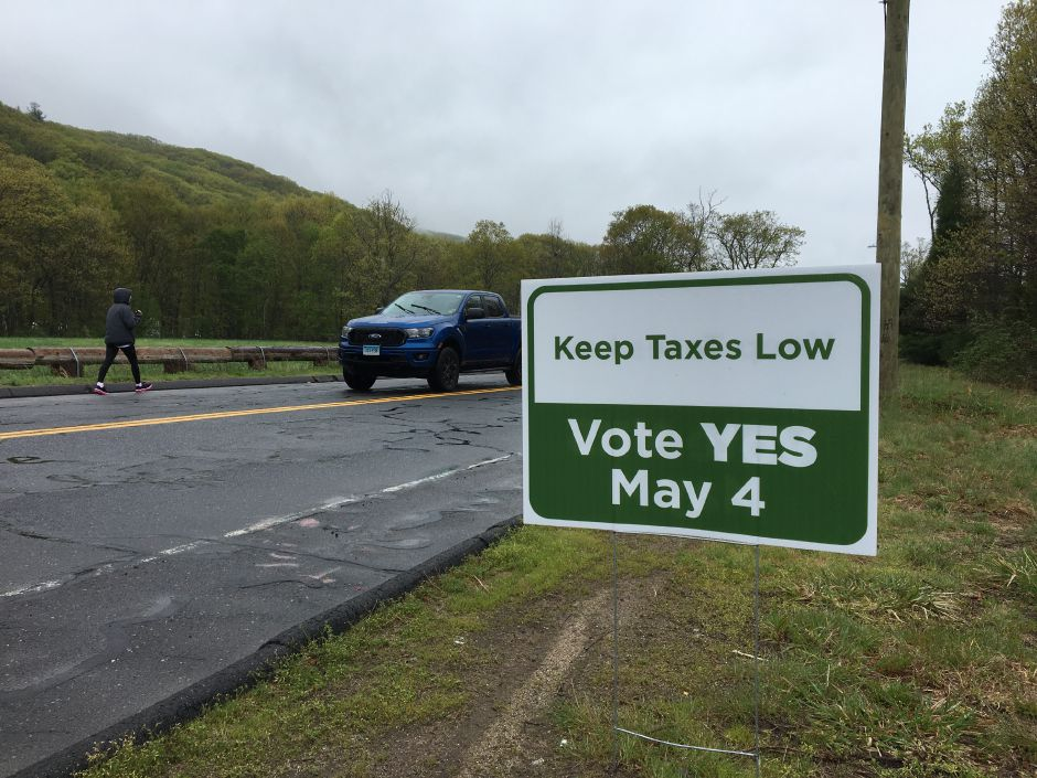 "A sign on Mount Vernon Road references this week's development rights referendum in Southington. A similar sign across the street reads ""Stop Overcrowding. Vote YES May 4."" 