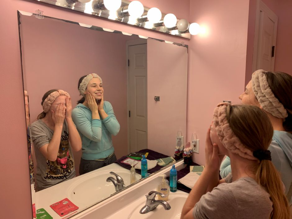 Kristen Dearborn has an at-home spa day with her niece Lila Yerman using sheet masks. |Kristen Dearborn, special to Record-Journal