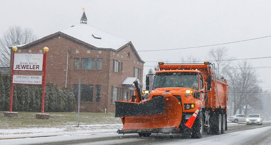 A snow plow travels on South Main Street in Plantsville, Tues., Jan. 26, 2021. Snow will continue into tonight bringing two to four inches of accumulation. Dave Zajac, Record-Journal