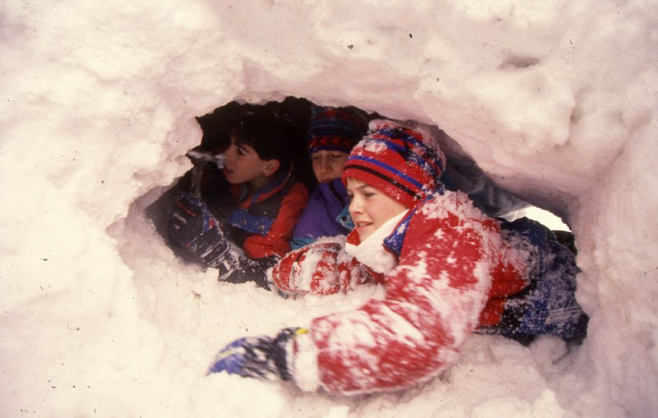 RJ file photo - Gabe Ravizza, Michael Pooler and Marc Pooler work on the inside of a snow fort on Hanover Street in Meriden Jan. 7, 1994.