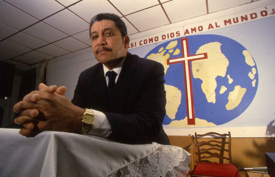 RJ file photo - The Reg. Roberto Rosario, pastor of Alpha & Omega Christian Church at 134 Springdale Ave. in Meriden Jan. 5, 1994.