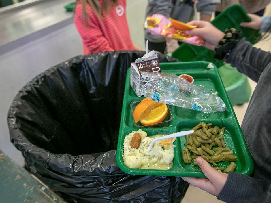Students discard food into separate receptacles at the end of their lunch period as part of a lunch waste composting program at Thalberg Elementary School in Southington, on Jan. 15. Dave Zajac, Record-Journal file photo