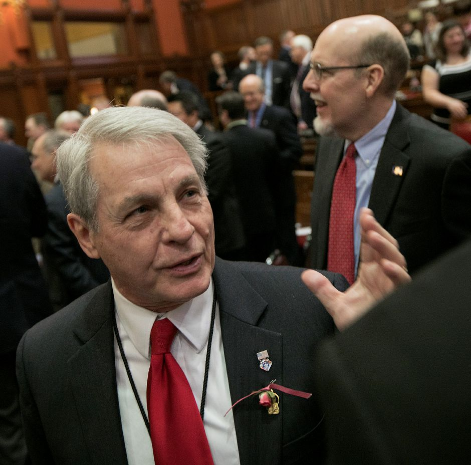 Republican Sen. Len Suzio, R-Meriden, talks to the press next to Sen. Joe Markley, R-Southington, top right, after the governor