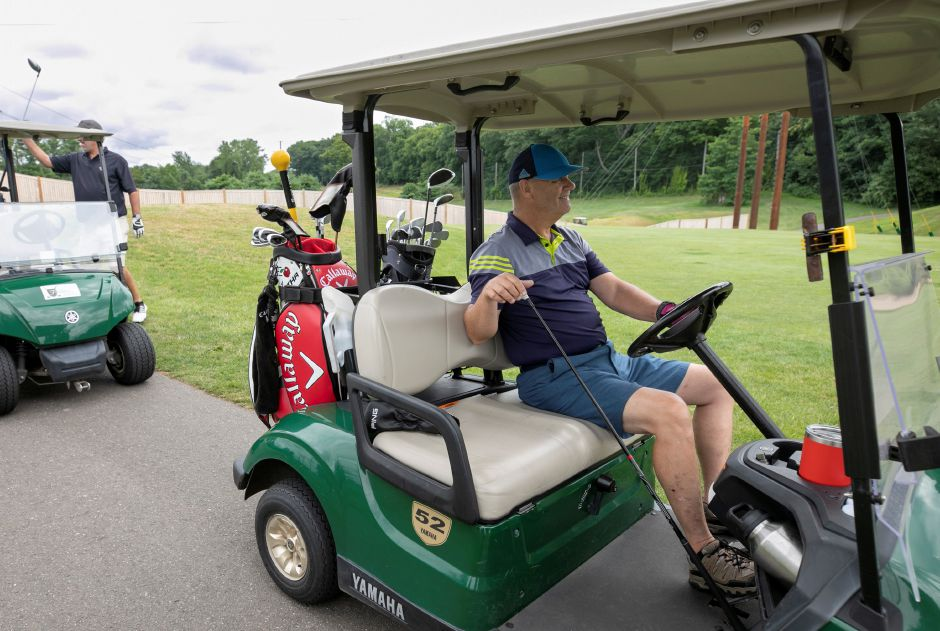 Dawson McNew, of West Haven, proceeds down the cart path after his tee shot on Hole 1 at Tradition Golf Club, 37 Harrison Rd., Wallingford, Wed., Jul. 15, 2020. Tradition Golf Club has been averaging more than 200 golfers per day. Dave Zajac, Record-Journal