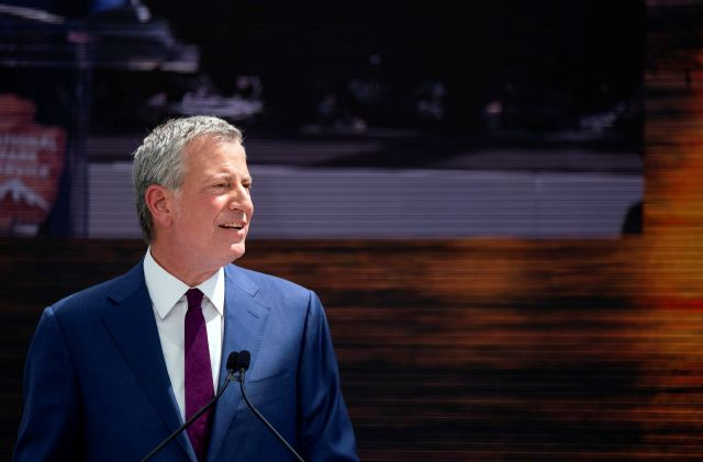 New York Mayor Bill de Blasio speaks during the official dedication ceremony of the Statue of Liberty Museum on Liberty Island Thursday, May 16, 2019, in New York. De Blasio announced Thursday that he will seek the Democratic nomination for president. (AP Photo/Craig Ruttle)