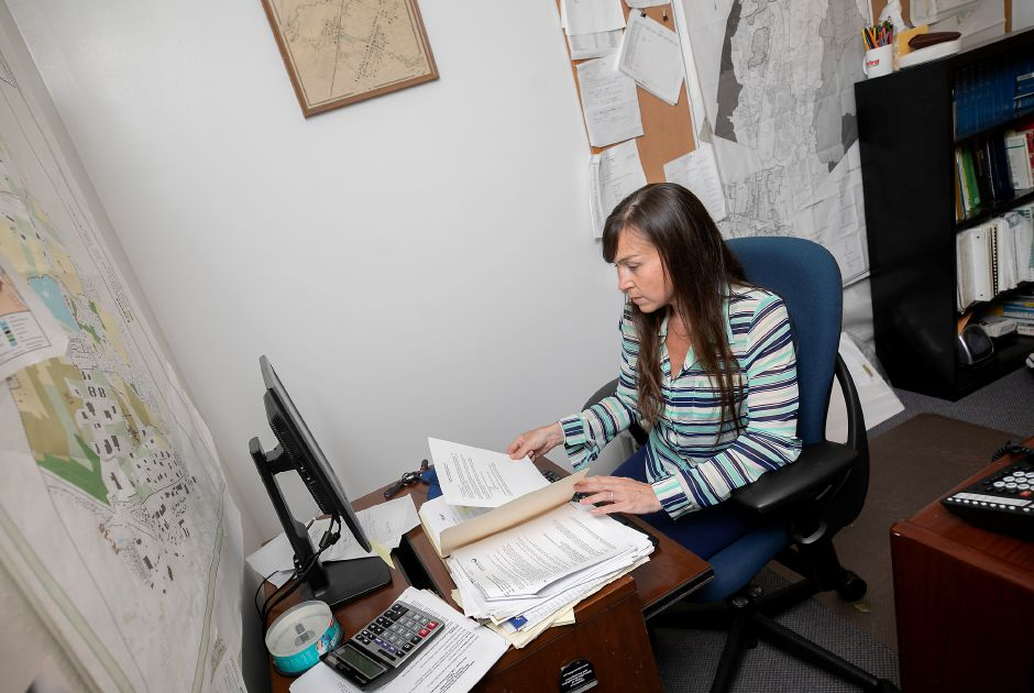 Town Planner Kacie Hand works at her desk in the planning office at Wallingford Town Hall on Tuesday. Hand is leaving at the end of the month after 12 years in the planning office. Dave Zajac, Record-Journal
