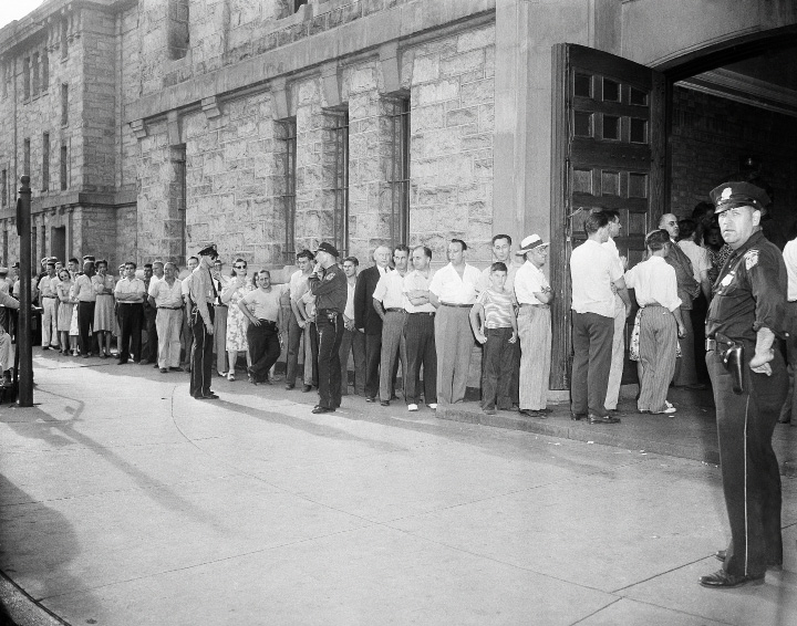 Before the huge drill shed of the State Armory, which was converted into a morgue, patrons of the Ringling Brothers and Barnum and Bailey circus line up to enter in an effort to identify bodies of more than 120 persons who perished when the big top burned during an afternoon performance in Hartford, Connecticut, July 6, 1944. (AP Photo)