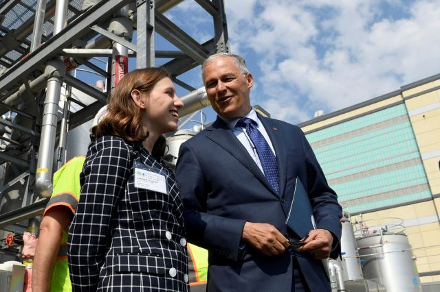 Democratic Presidential candidate Washington Gov. Jay Inslee, right, talks with 13-year-old climate justice activist Alexandria Villaseñor, left, as he tours the Blue Plains Advanced Wastewater Treatment Plant in Washington, Thursday, May 16, 2019, during an event where he unveiled part of his plan to defeat climate change. (AP Photo/Susan Walsh)