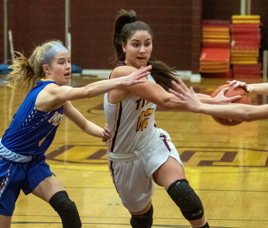 Sheehan's Caitlyn Velez gets fouled by Mercy's Avery Kohs as she drives to the basket during the first half at Sheehan High School on Friday, February 14, 2020. Aaron Flaum, Record-Journal