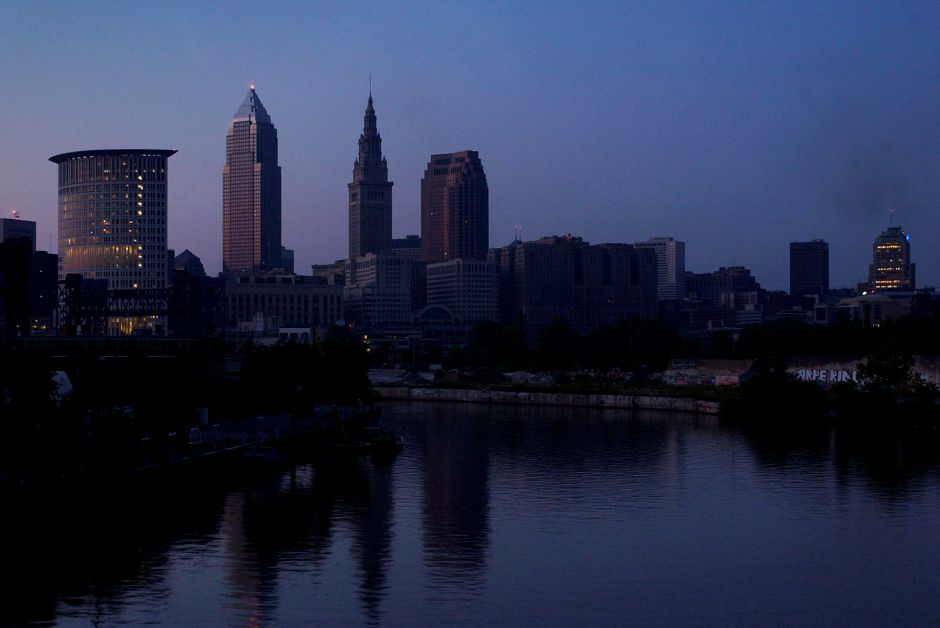 The city of Cleveland sits in the dark Thursday, Aug. 14, 2003, except for emergency lights in the Federal Courthouse, left, and the SBC building, far right, after a massive power outage struck the eastern United States and parts of Canada. (AP Photo/Mark Duncan)