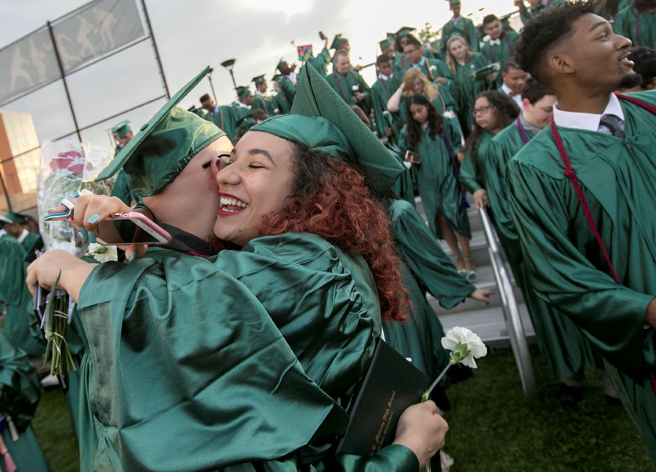 Graduates Kiara Gonzalez and Stephen Lorenzo embrace at conclusion of graduation ceremonies at Maloney High School in Meriden, Tuesday, June 13, 2017. | Dave Zajac, Record-Journal