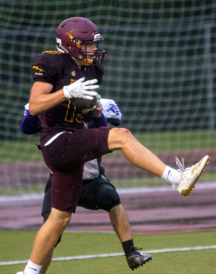 Garrett Molampy comes down with a touchdown reception during Friday's scrimmage against North Branford at Riccitelli Field. | Aaron Flaum, Record-Journal