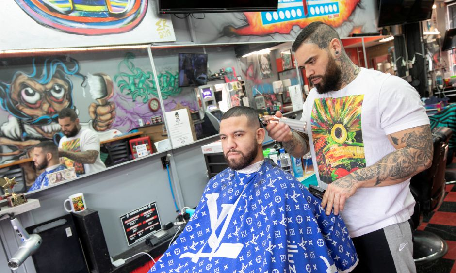 Barber Eddie Rivera trims the hair of customer Rene Rivera, of Hartford, at Feel Fresh barbershop on West Main Street in Meriden, Wed., Feb. 26, 2020. Dave Zajac, Record-Journal
