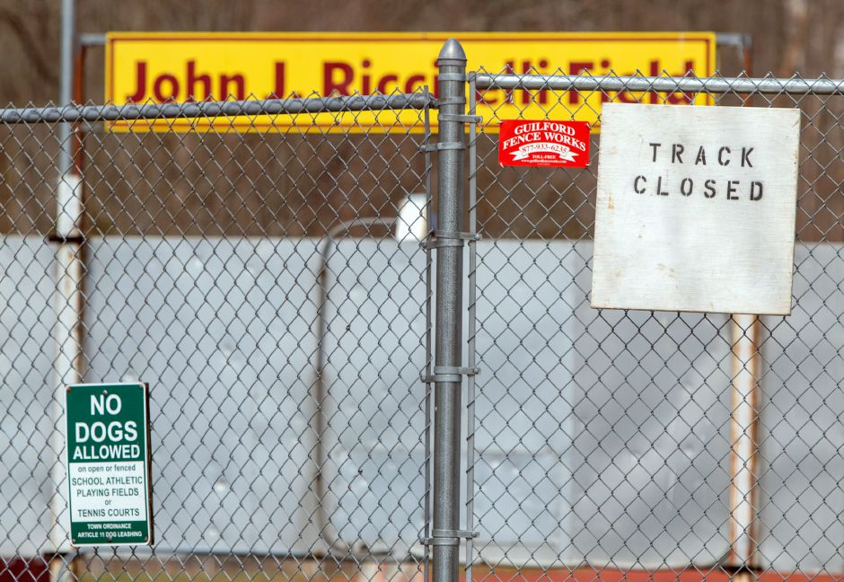 A sign hangs outside John J. Ricitelli Field at Sheehan High School letting the public know that track is closed at all the high school on Tuesday, March 31, 2020. Aaron Flaum, Record-Journal