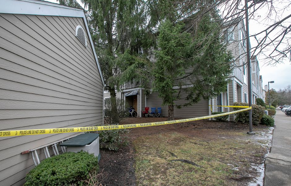 Police tape blocks off an area next to Building 8 at Flats at 390 on Bee Street in Meriden, Fri., Dec. 27, 2019. Police were investigating after gunshots were fired at the apartment complex on Dec. 26. Dave Zajac, Record-Journal