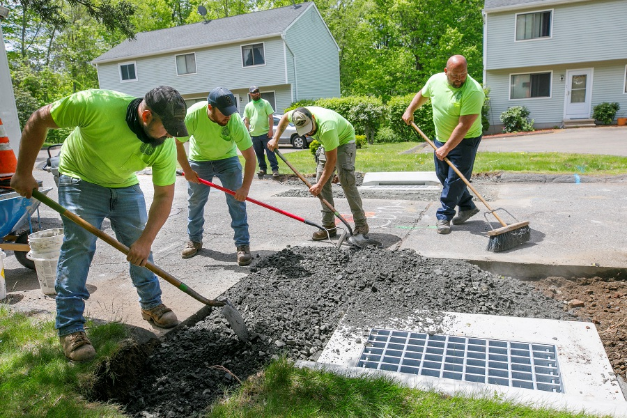 City of Meriden Highway Division workers finish up changing out a catch basin on Birdsey Avenue in Meriden on  Thursday. For the first time, National Public Works Week will be celebrated in Meriden. Photos by Dave Zajac, Record-Journal