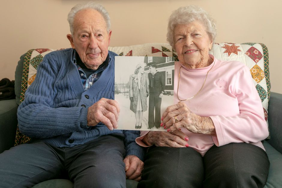 "Ruth and Bob ""Bus"" Williams hold a picture taken of them on their wedding day in 1945, Thurs., Feb. 13, 2020. The couple celebrated their 75th wedding anniversary on Jan. 27. Dave Zajac, Record-Journal"