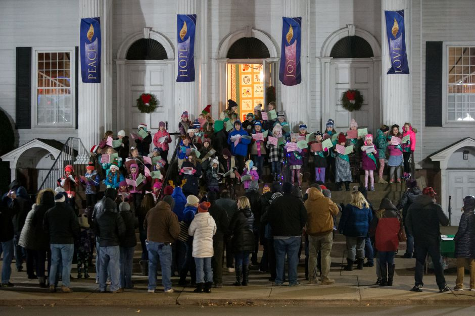 A crowd gahters on the steps of the First Congregational Church to sing carols Friday during White Christmas in the Community in downtown Southington December 7, 2018 | Justin Weekes / Special to the Record-Journal