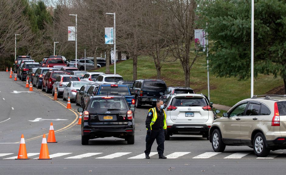 Cars wait in line at the entrance to MidState Medical Center in Meriden to get a COVID-19 test on Thursday, November 19, 2020. Aaron Flaum, Record-Journal