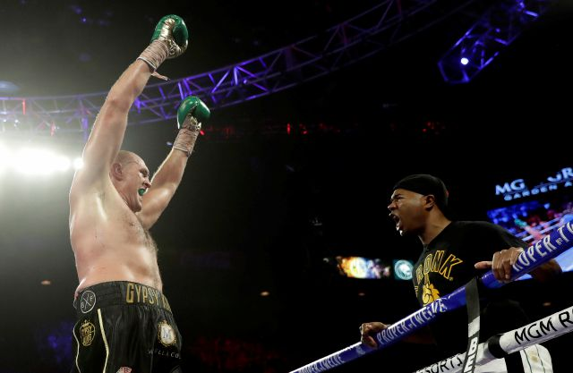 "Tyson Fury, left, of England approaches his trainer Javon ""SugarHill"" Steward after defeating Deontay Wilder in a WBC heavyweight championship boxing match Saturday, Feb. 22, 2020, in Las Vegas. (AP Photo/Isaac Brekken)"