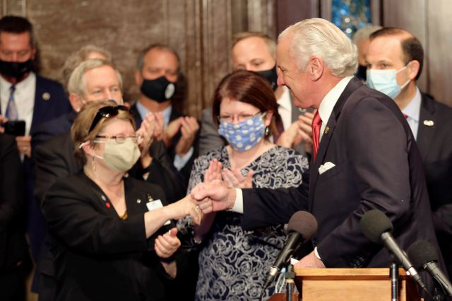 "South Carolina Gov. Henry McMaster, right, fist bumps South Carolina Citizens for Life Executive Director Holly Gatling, left, before McMaster signed a bill banning almost all abortions in the state on Thursday, Feb. 18, 2021, in Columbia, S.C. On the same day, Planned Parenthood filed a federal lawsuit to stop the measure from going into effect. The state House approved the ""South Carolina Fetal Heartbeat and Protection from Abortion Act"" on a 79-35 vote Wednesday and gave it a final..."