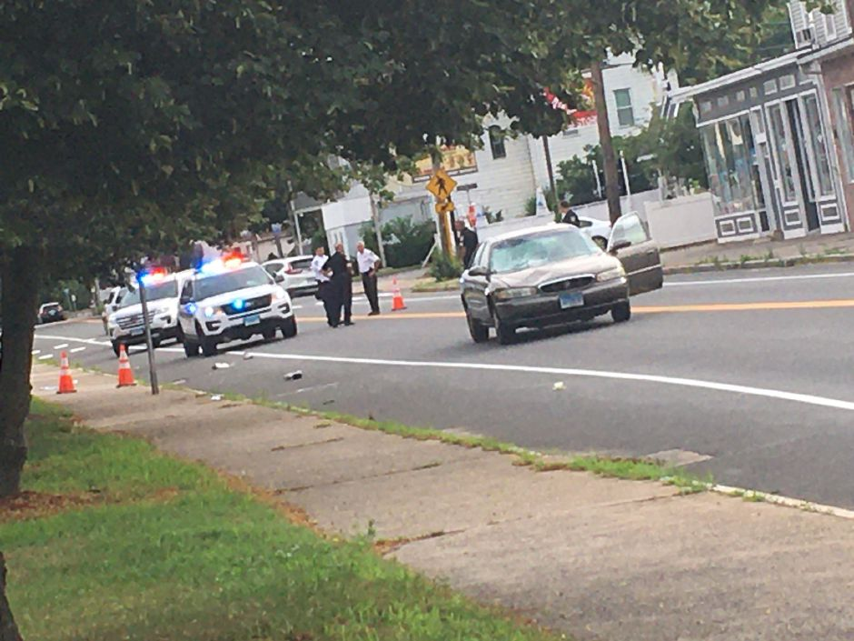 Wallingford police investigate a pedestrian struck by a vehicle Friday morning, in the area of Church Street on Route 5, July 10, 2020. | Lauren Takores, Record-Journal