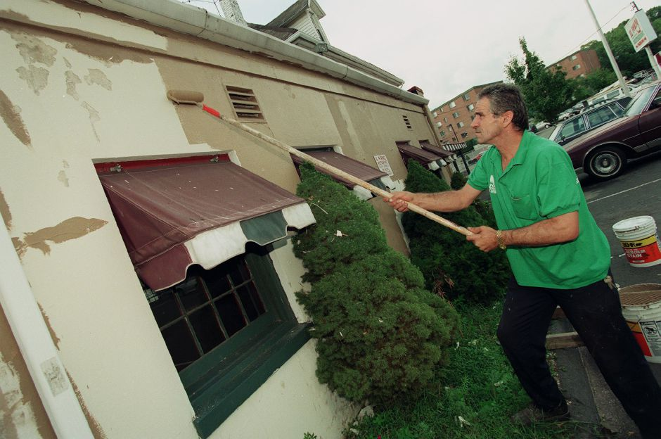 Rustem Gjonbalaj, owner of Il Forno Restaurant on Hanover St., adds a new coat of paint to the building Sept. 21, 1999, anticipating a re-opening in about a week.