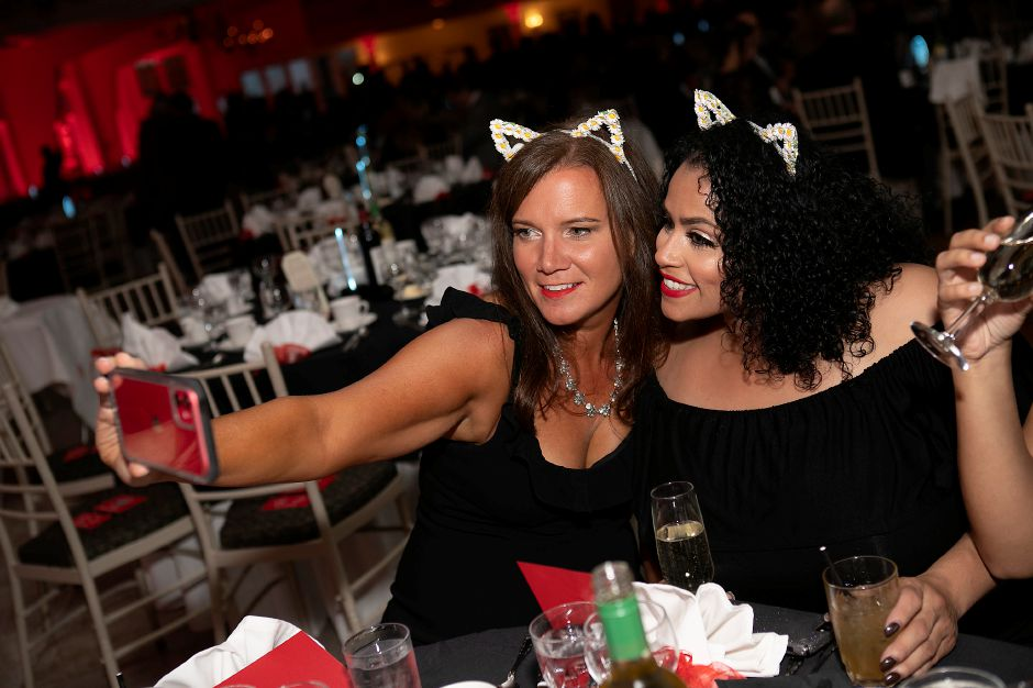 Two women pose for a selfie during the event.