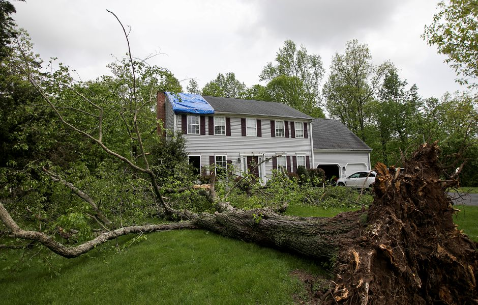 A large tree damaged this house on Kondracki Lane in Wallingford during Tuesday