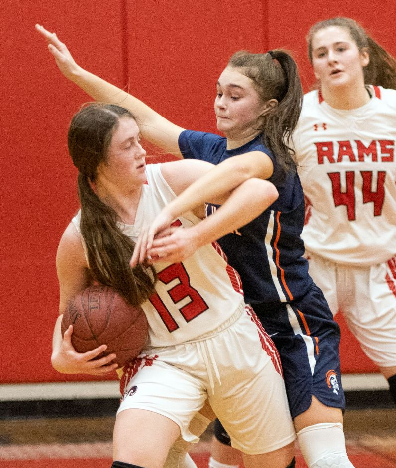 Cheshire's Ariana Perlini keeps the ball away from Lyman Hall's Grace Gagliardi during the first half at the Cheshire High School East Gym on Tuesday, January 21, 2020. Aaron Flaum, Record-Journal