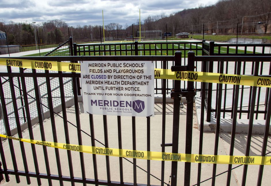 A sign by Platt's new turf field is letting the public know that all the athletic fields and playgrounds at all the Meriden Public Schools are closed due to the COVID-19 outbreak on Tuesday, March 31, 2020. Aaron Flaum, Record-Journal