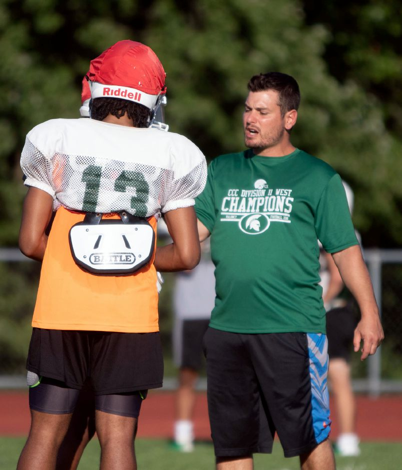 Maloney head coach Kevin Frederick talks with Kamron Moreno during football practice on Monday August 26, 2019. Aaron Flaum, Record-Journal