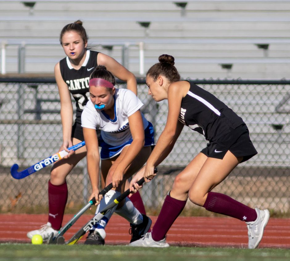 Southington's Anna McGrail tries to get past Canton's Mika Stamos during the first half of Wednesday's CCC field hockey game at Southington High School. Canton won 2-0.