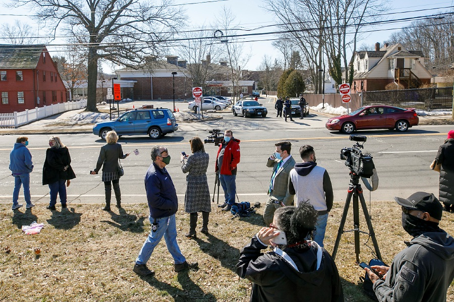People gather along West Main Street in Meriden as First Lady Jill Biden and U.S. Education Secretary Miguel Cardona visit Benjamin Franklin Elementary School across the street Wed, Mar. 3, 2021. Dave Zajac, Record-Journal
