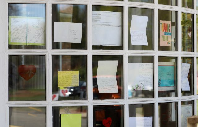 Notes for healthcare workers hang in the front window at the Kimberly Hall North nursing home, Thursday, May 14, 2020 in Windsor, Conn. The coronavirus has had no regard for health care quality or ratings as it has swept through nursing homes around the world, killing efficiently even in highly rated care centers. Preliminary research indicates the numbers of nursing home residents testing positive for the coronavirus and dying from COVID-19 are linked to location and population density...