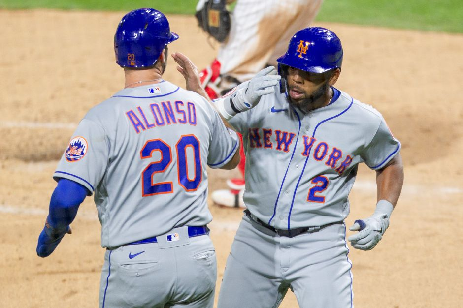 New York Mets Dominic Smith (2) celebrates with Pete Alonso (20) after hitting a two run homer during the fourth inning of a baseball game against the Philadelphia Phillies, Tuesday, April 6, 2021, in Philadelphia. (AP Photo/Laurence Kesterson)