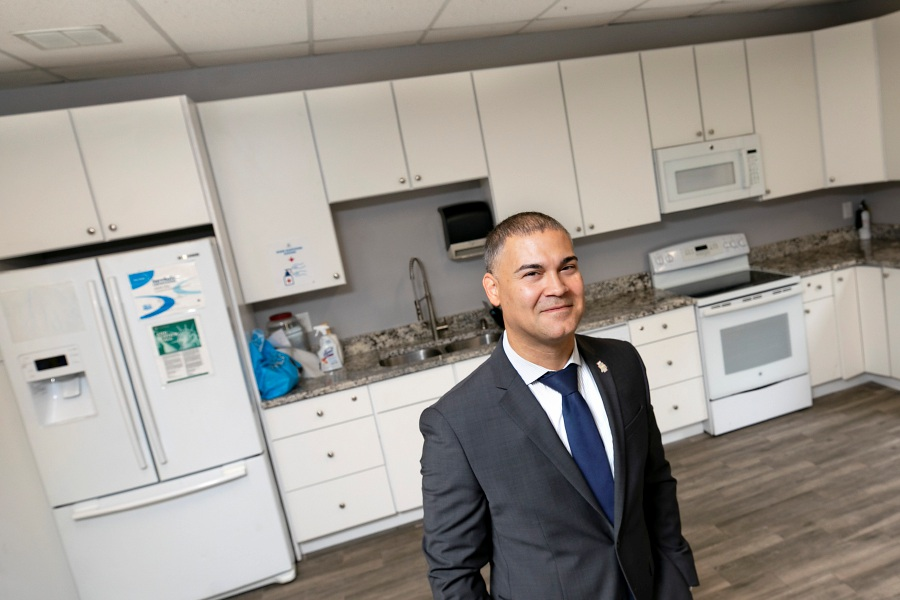 Carlos Collazo, executive director of the Ulbrich Boys and Girls Club in Wallingford, stands in the newly renovated kitchen of the clubhouse, Thurs., Sept. 17, 2020. Children at the Ulbrich Boys and Girls Club will soon have access to expanded cooking classes and more space for crafts and activities in the renovated kitchen. Dave Zajac, Record-Journal