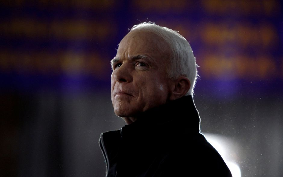 Republican presidential candidate Sen. John McCain, R-Ariz., waits as he is introduced to speak at a rally in Cedar Falls, Iowa, Sunday, Oct. 26, 2008. (AP Photo/Carolyn Kaster)
