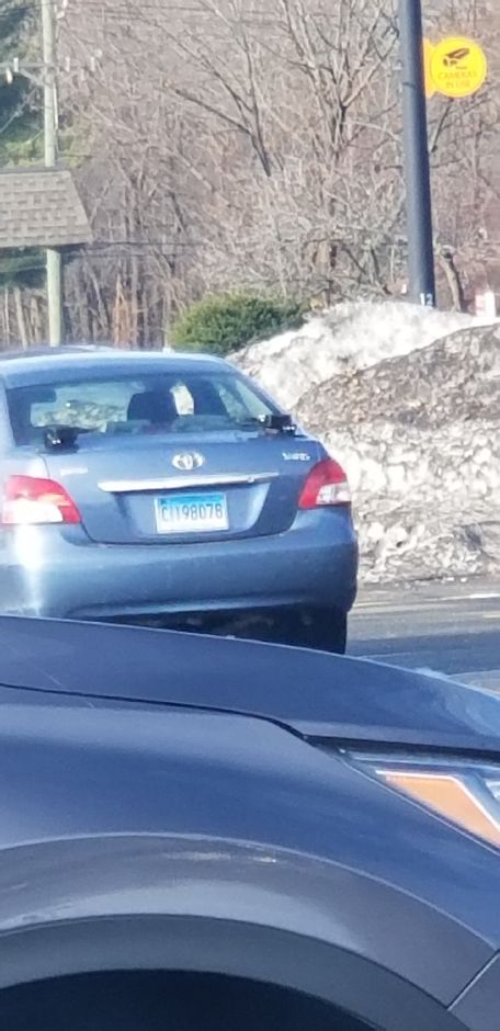 A car from Northeast Storage & Transport collecting license plate numbers at a parking lot in Southington earlier this month. The system