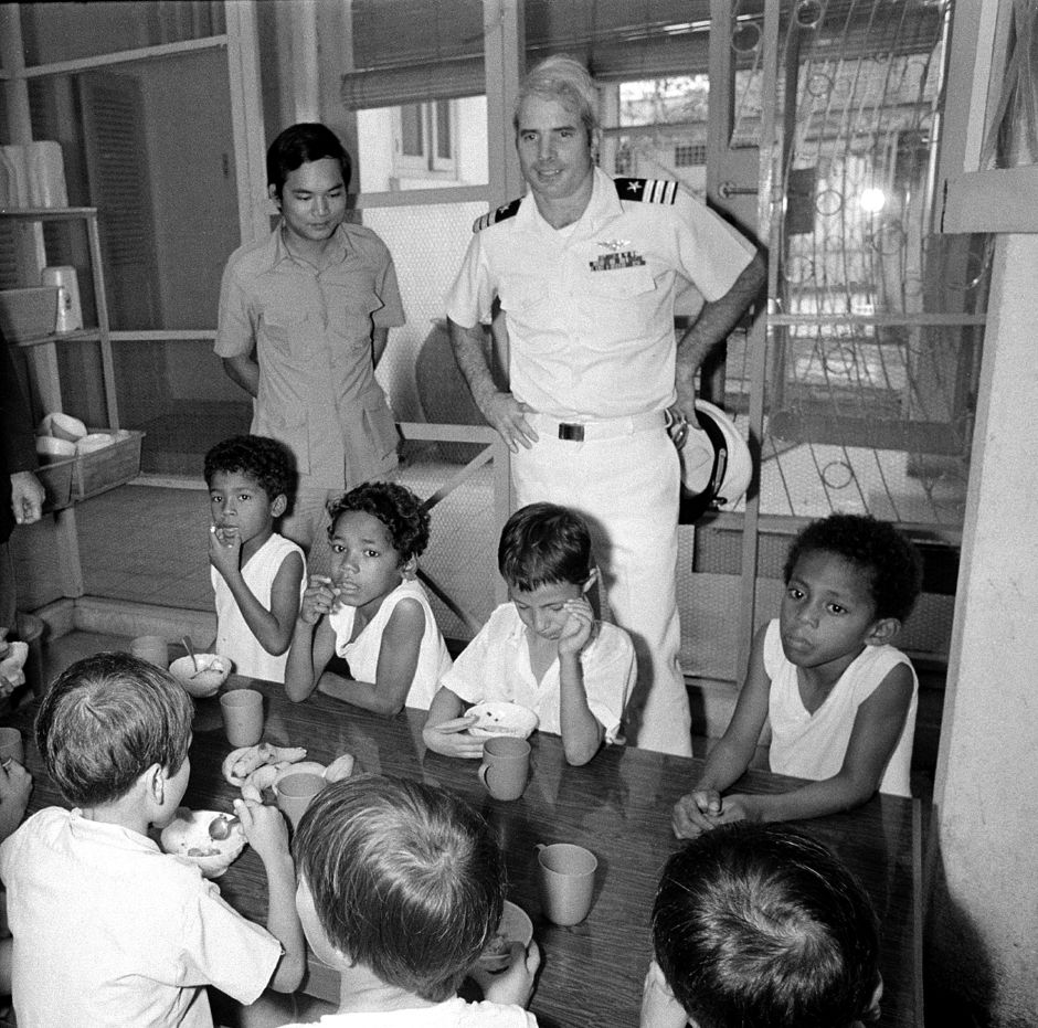 ,U.S. Navy Commander John S. McCain 3rd, a guest of the South Vietnamese government, visits an orphanage that cares for youngsters fathered by American G.I.s. in Saigon, Vietnam, on Oct. 30, 1974. McCain, a son of the admiral who commanded U.S. forces in the Pacific at the height of the Vietnam War, was shot down over Hanoi and spent several years as a POW. (AP Photo/Dang Van Phuoc)