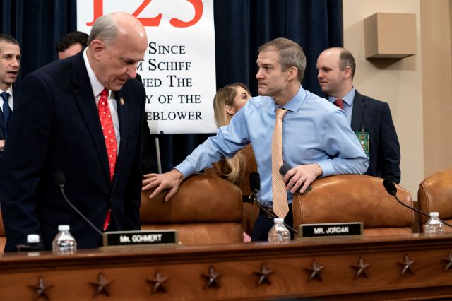 Rep. Louie Gohmert, R-Texas, left, and Rep. Jim Jordan, R-Ohio, arrive for the vote on two articles of impeachment against President Donald Trump, Friday, Dec. 13, 2019, on Capitol Hill in Washington. (AP Photo/J. Scott Applewhite)
